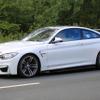 BMW 最強レースカー「M4 GT4」、フルエアロ装着の公道テストをキャッチ! 画像